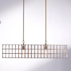 Loft Chandelier. The architecture of the city has inspired the Loft pendant and Chandelier collection. As if to look through the large glass windows of an urban skyscraper, this collection embraces the vertical lines of the city. Adding an antique brass finish gives a touch of warmth to this collection only found in the heart of the city. Two brass sockets and mounting rods, instead of chain, are evocative of the structural high-rises to create an elegant skyline in any home. Luxury Chandelier, Bronze Pendant, Antique Brass, Clear Glass, Skyscraper, Household, Loft, Skyline, Bulb