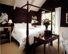 I love this one!!! Dark chocolate walls and planked white ceiling