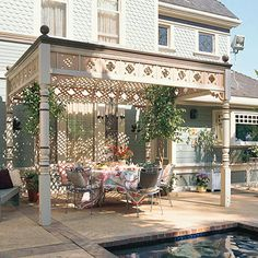 Pergola with Ornamental Detail  The more detailing on a home's exterior, the easier it is to introduce similar complexity to an outdoor structure. This pergola's turned ornamental posts, scrollwork frieze, and lattice roof mimic the surfaces found on its Victorian home counterpart.