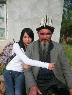 Beautiful Kyrgyz girl with her grandad.