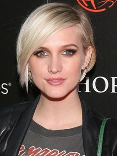 Digging the short hair, deep part and side-swept bangs