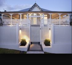 The fence decor suits the Queenslander style perfectly #fencingandscreens