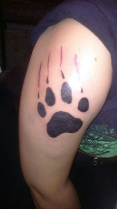 Wolf footprint tattoo