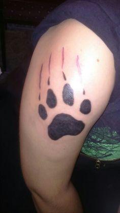 Wolf footprint tattoo