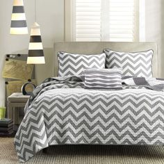 Update the look and feel of your bedroom with the Mi Zone Libra Coverlet Set. An oversized chevron pattern is displayed in vibrant white and blue hues, while a smaller scaled grey and white chevron adorns the reverse. Both the coverlet and sham(s) are fully reversible, giving you the option to mix & match the different chevron prints and customize your bedroom. An oblong pillow with fabric manipulated details adds charm and dimension to bedding set. Made from ultra-soft microfiber, this c...