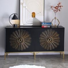 Bring a perfect addition for storage solution while increasing storage space with this eye-catching accent sideboard buffet. Featuring a rectangular silhouette and the black embossed patterns in gold finish, this sideboard buffet enjoys an artful appeal. Fitted with doors to reveal interior shelves and ample space to store kitchen items, beautiful and practical. And, the smooth top can accommodate some decorative objects to make a neat and ornamental statement. Founded atop four stainless steel Black Buffet, Black Sideboard, Sideboard Buffet, Modern Materials, Vintage Buffet, Contemporary Decor, Wood Colors, Adjustable Shelving, Modern Shelving