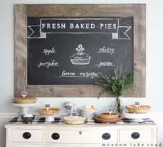 Fresh baked pies chalkboard sign over pie buffet | www.meadowlakeroad.com #crateholiday #piebar