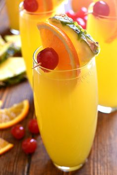 These Tropical Mimosas are my favorite new breakfast cocktail! They combine traditional mimosas with Malibu Rum and pineapple juice for a tropical drink that's perfect for summer!