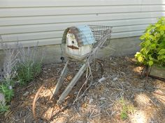Old Plow with bird house in garden