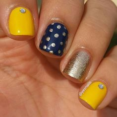 Navy blue and yellow mani with gold polka dots