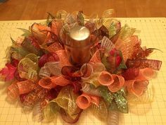 This deco mesh centerpiece is full of color and texture! Sparkly leaves, and silk leaves accent this centerpiece! Includes the gold candle and Deco Mesh Crafts, Wreath Crafts, Diy Wreath, Wreath Ideas, Christmas Centerpieces, Thanksgiving Decorations, Burlap Centerpieces, Fall Decorations, Deco Mesh Wreaths