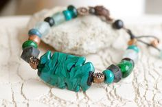 Bracelet: handmade artisan lampwork glass beads wood recycled glass copper bronze clasp ethnic malachite green gray brown black organic