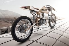 Honda Supersport mods all project an air of luxury, but the shop's latest masterpiece screams it. The Eden has a beautiful handmade steel Motorbike Design, Honda Cub, Moped Scooter, Futuristic Motorcycle, Cycle Chic, Supersport, Honda Motorcycles, Love Car, Custom Bikes