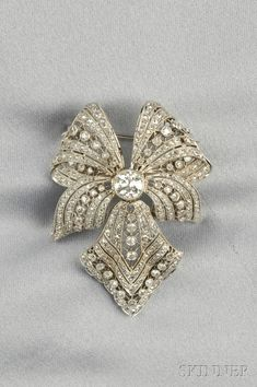 Edwardian Platinum and diamond bow brooch.