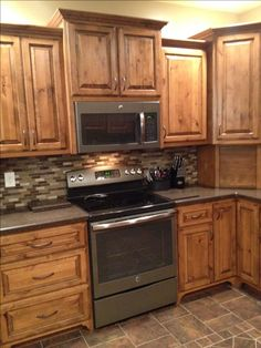 For putting microwave over stove. Have Jeff build me a new deeper cabinet over it. Cabinetry by Huskey Cabinets, Minturn, AR.