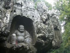 *Happy Buddha carved in the rock