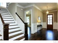 love the staircase with dark steps and white molding