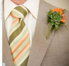 Joey's colorful tie and boutonniere, made of spray roses and succulents, popped against his taupe suit and perfectly matched the orange-and-green color scheme.
