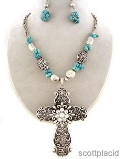 """CHUNKY 95MM LONG CROSS THEME SILVER TONE METAL COATED OVER ACRYLIC NECKLACE SET WITH CLEAR CRYSTALS AND RECONSTITUTED TUQUOISE ACCENTS    * If you need a necklace extender I have them for sale in my store.*         NECKLACE: 20"""" L + EXT     LOBSTER CLAW CLOSURE       HOOK EARRINGS           COLOR: SILVER TONE  $23.99"""