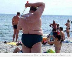 f0a8c0c904adc29d3e90cb1438a04fa1  suntan lotion paint rollers - Free funny vacation photos
