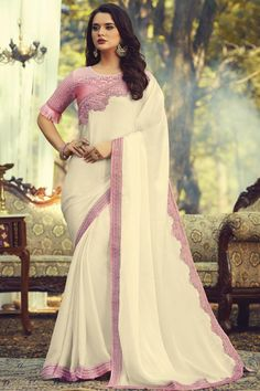Online Shopping of Party Style Fancy Art Silk Fabric Saree With Embroidered Blouse In Off White Color from SareesBazaar, leading online ethnic clothing store offering latest collection of sarees, salwar suits, lehengas & kurtis Georgette Sarees, Silk Sarees, Party Wear Sarees Online, Net Blouses, Plain Saree, Bollywood Saree, White Silk, Pearl White, Off White Color