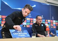 Napoli's forward from Belgium Dries Mertens (L) and Napoli's coach from Italy Maurizio Sarri arrive to give a press conference on the eve of the UEFA Champions League football match SSC Napoli vs FK Dynamo Kiev on November 22, 2016 at the SSC Napoli headquarters in Naples. / AFP / CARLO HERMANN