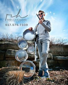 Senior pictures with drums, drumsticks and blue skies.  Great guy poses.