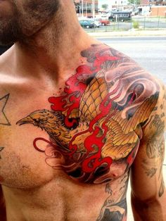 Mens Chest #Tattoo With A Phoenix