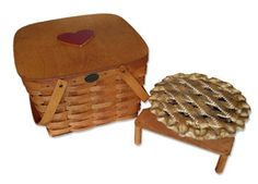 This beautiful 2-Pie Basket with Red Heart Accented Lid makes the perfect gift for that special Valentine to use year-round.  The solid birch lid with heart piece is attached with dual hinges on the back. This basket also includes a removable pie tray which allows you to stack two pies inside; may we suggest some favorites like Strawberry-Rhubarb, Peach, Pumpkin or Apple. On Sale: $59.00