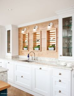 Wooden textures and wall lighting can offer a traditional feel to modern designs #prismaticwalllights #originalbtc #kitchenlighting: