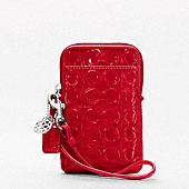 Coach phone case - matches my cruise red patent cross-shoulder!  OK yes please.
