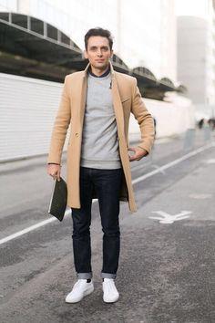 Camel topcoat, grey sweatshirt, navy shirt, jeans, white sneakers