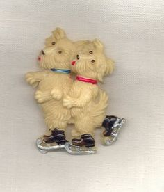 Vintage Fashion Guild: 1930s - Celluloid Skating pups
