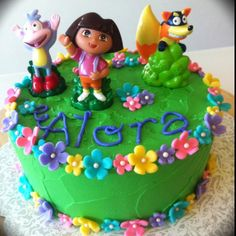 Dora cake - flowers we liked but in orange, pink and purple :)