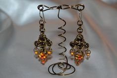 Pretty chainmaille earrings hand-made by my friend Colin. Check them out on Etsy!! So pretty.