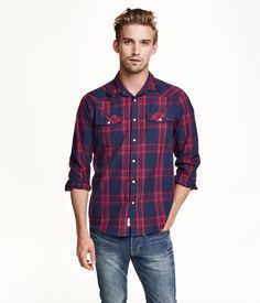 Plaid shirt in woven cotton fabric. Turn-down collar, chest pockets with  flap and snap fastener, and snap fasteners at front and at cuffs.