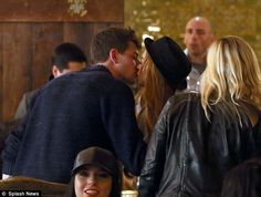 Public smooch: Lindsay Lohan didnt care who saw her as she kissed new man Avi Snow in a Santa Monica bar on Saturday