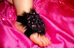 Barefoot baby crib sandles with feathers. $7.99, via Etsy.