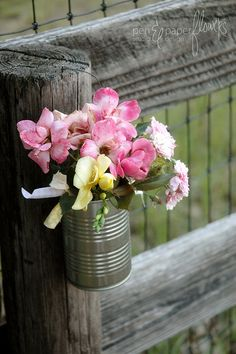 scatter fresh cut flowers in tin cans around at your outdoor party....
