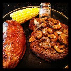 Steak topped w/ mushroom & onions, few dashes of ghost pepper salt, sweet potato, and corn on the cob.