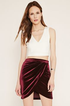 A knit velvet mini skirt with a tulip hem and a concealed side zipper.
