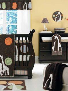 Giraffes, dark furniture, sleigh crib?