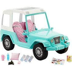 The colorful jeep is designed with a teal body, a white roof (with open sunroof and windows), two pink seats and gray seatbelts. Decorate with fun icons like hearts, the earth and rainbows to add personal style to the Barbie vehicle. Barbie Doll Car, Barbie Sets, Barbie Dream, Barbie House, Mattel Barbie, Pink Barbie, Barbie Stuff, Ken Doll, Toys R Us