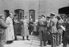Key Nazis in British custody: Admiral Doenitz, Hitler's designated successor (dark uniform). To his left, General Jodl,  Chief of the Operations Staff of the Armed Forces High Command. To his right, Albert Speer, Hitler's favorite architect and Munitions Minister. Jodl was hanged; the other two served prison sentences and were released to die free men.
