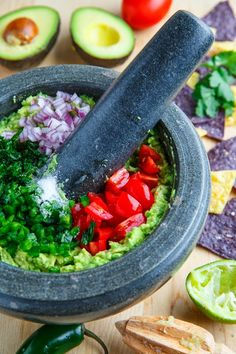 Guacamole    2 large avocados, mashed     2 tablespoons lime juice (~1 lime)     1 jalapeno pepper, finely diced     1 romano/plum tomato, seeded and finely diced (optional)     1/4 cup red onion, finely diced     2 tablespoons cilantro, chopped     salt to taste