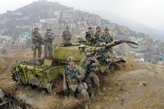 Karl Gatke, Sergeant First Class, Oregon National Guard Afghanistan, above Kabul with a Russian tank. First row, far right.