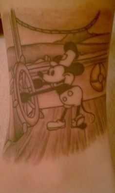 Mickey Mouse and classic Steamboat Willie.  It was done by Chris at Immortal Images in Charlotte, NC.