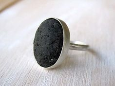 FREE SHIPPING ( REGISTERED MAIL ) WORLDWIDE!    This unique ring is made of 925 sterling silver and authentic Lava.  Lava stone is an actual stone