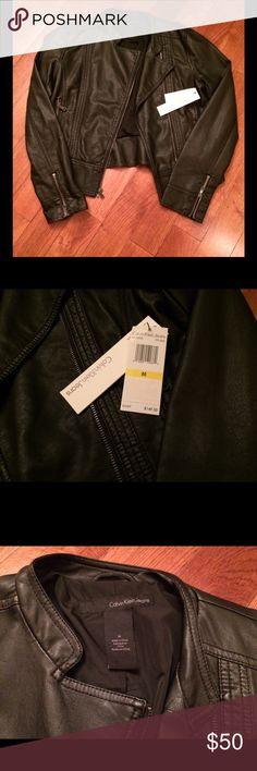 Calvin Klein Faux Leather Jacket Calvin Klein Faux Leather Jacket Women's Size Medium  New With Tags There are a couple tiny indent marks. I'm not sure where they came from. It's been hanging in my closet and didn't notice until I took the pics to list on here.  Price reflects. It is a top quality coat! Calvin Klein Jackets & Coats