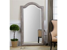 """This gorgeous arch top distressed floor mirror features a carved solid wood frame, natural finish accented with a light gray wash, and a generous 1 1/4 inches bevel. 37"""" x 68"""" x 2"""""""